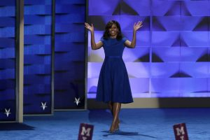 PHILADELPHIA, PA - JULY 25: First lady Michelle Obama walks on stage to deliver remarks on the first day of the Democratic National Convention at the Wells Fargo Center, July 25, 2016 in Philadelphia, Pennsylvania. An estimated 50,000 people are expected in Philadelphia, including hundreds of protesters and members of the media. The four-day Democratic National Convention kicked off July 25. (Photo by Alex Wong/Getty Images)