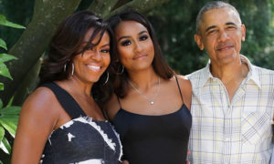 Sasha Obama with parents Michelle and Barack Obama