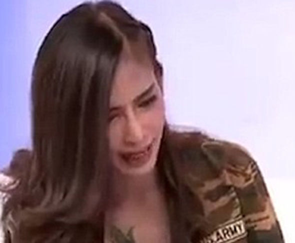 Model 'possessed by cannibal ghost' demands PIG BLOOD live on TV
